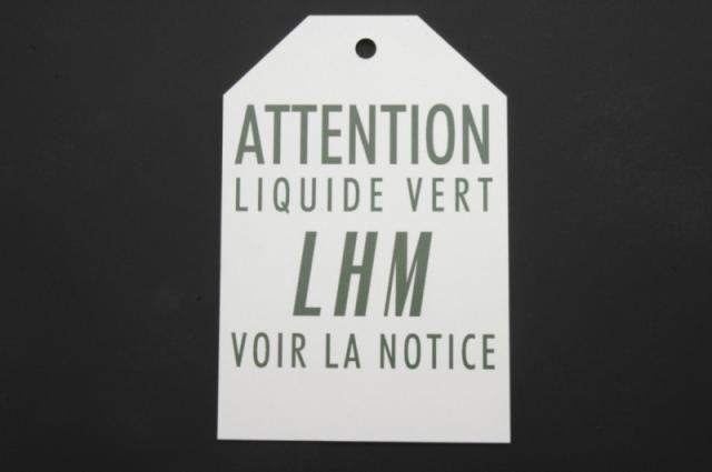 "Sign ""attention liquide vert, voir notice"""