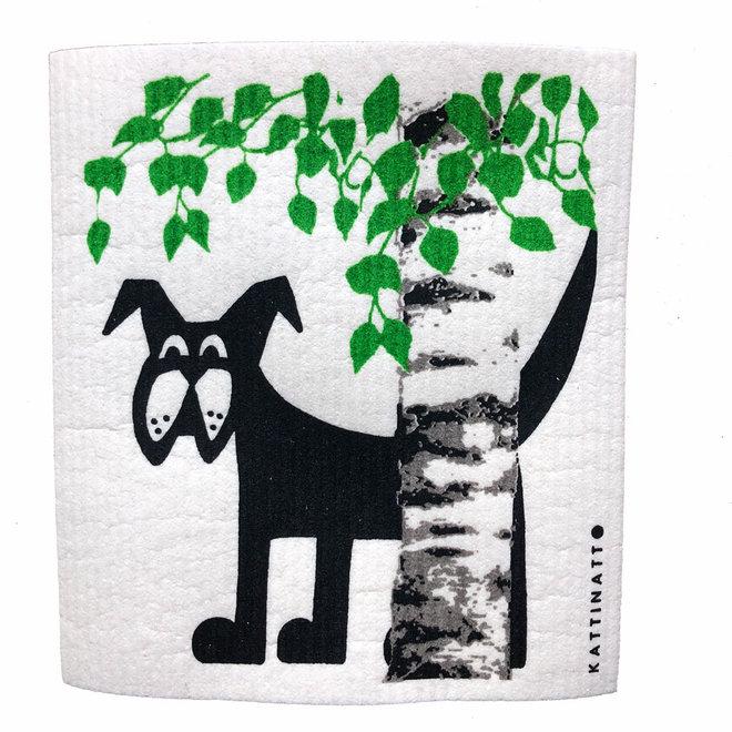 Dishcloth Dog behind Birch tree