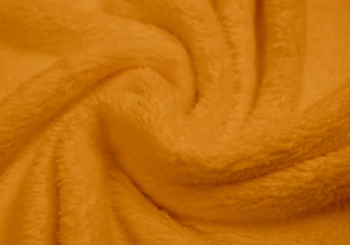 De Stoffenkamer Wellness Fleece okergeel