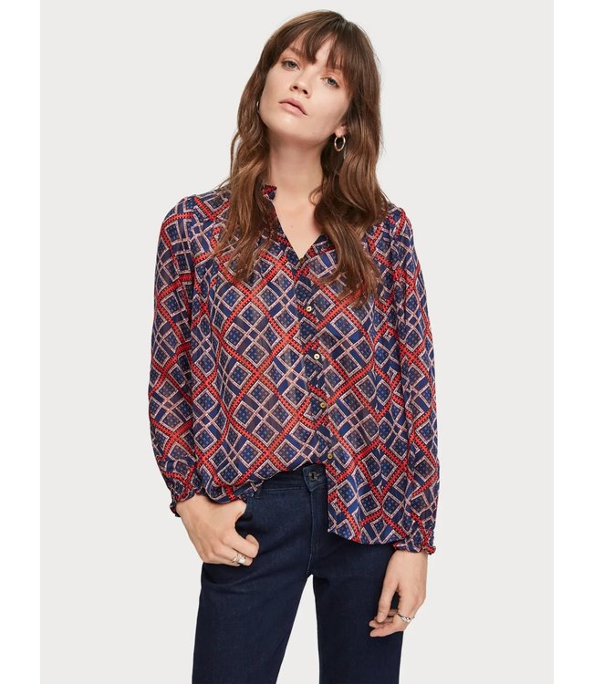 Amsterdams Blauw 153762 Sheer ruffle top with allover prints.