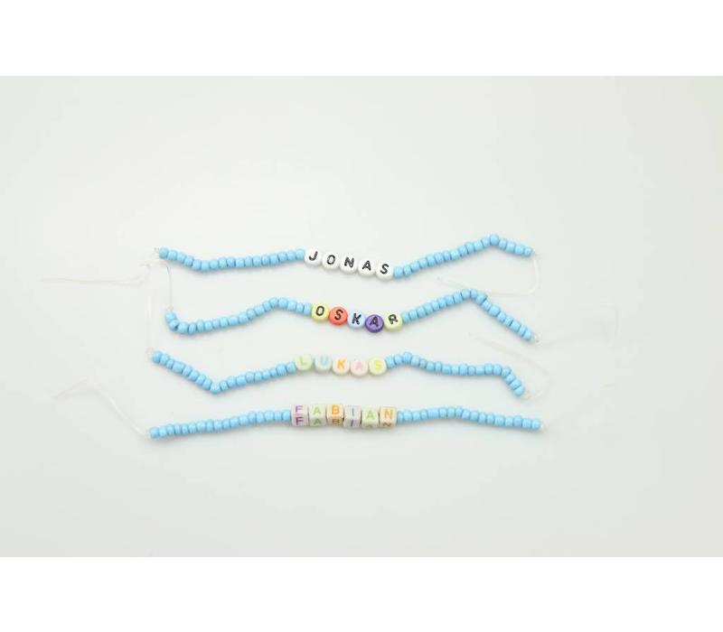 Name ribbon with letter beads