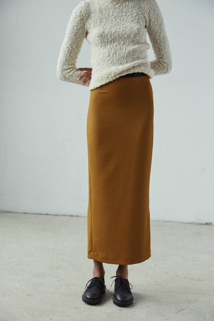 Native skirt bronze