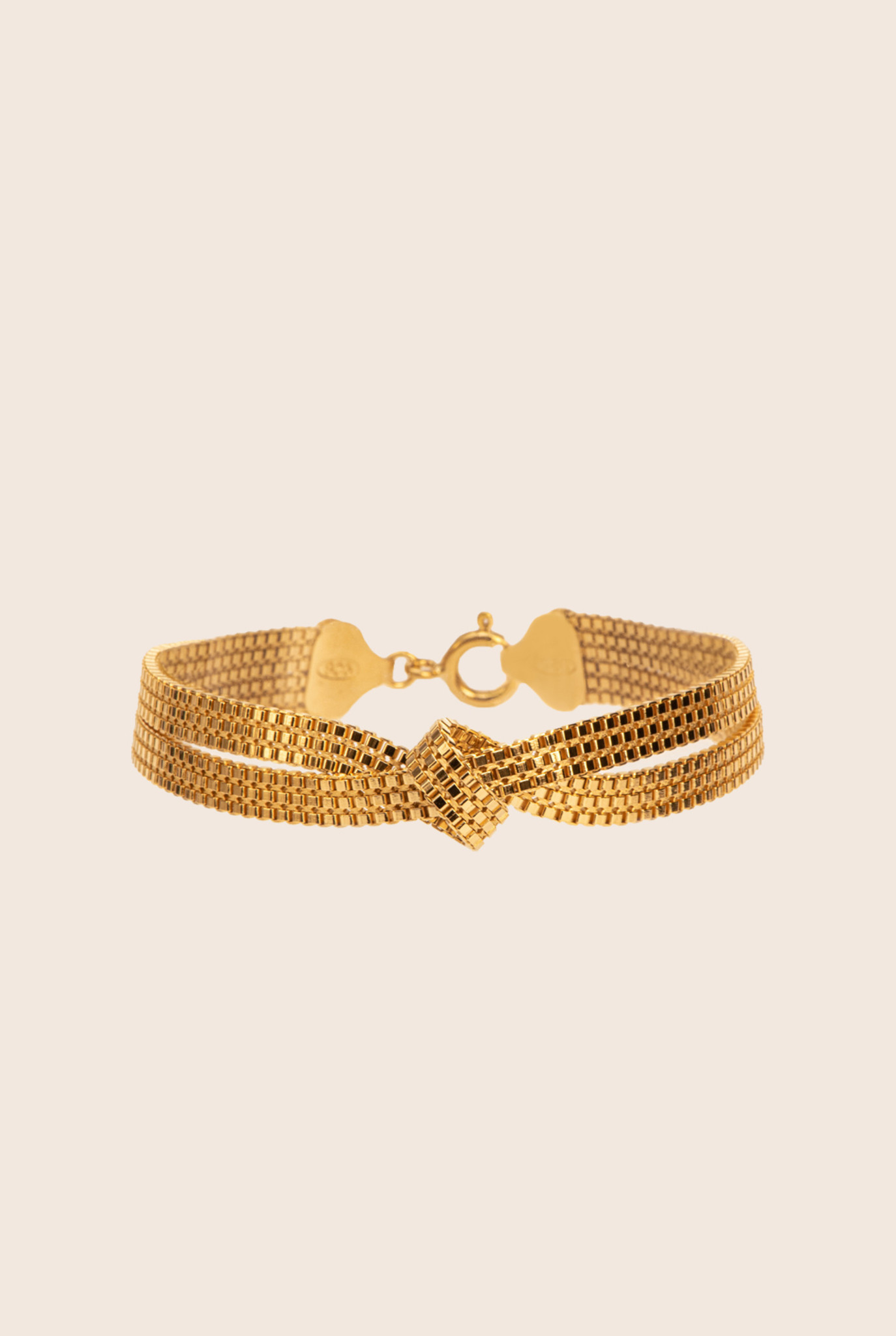 Flat chain bracelet with knot detail gold plated