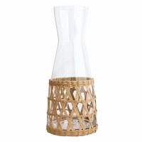 Glazen kan met rieten handvat