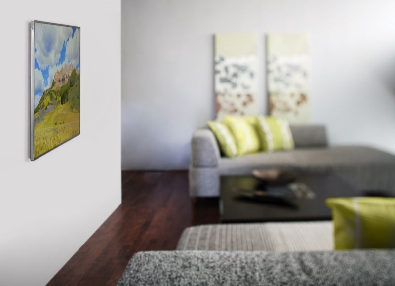 a living room space with a tv attached to the wall via wall mount