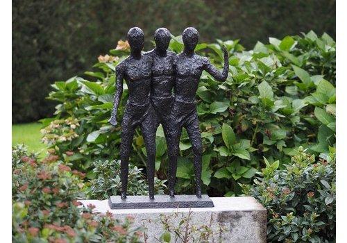 Bronzen beeld van drietal mannen