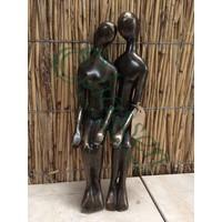 Bronzen koppel zittend