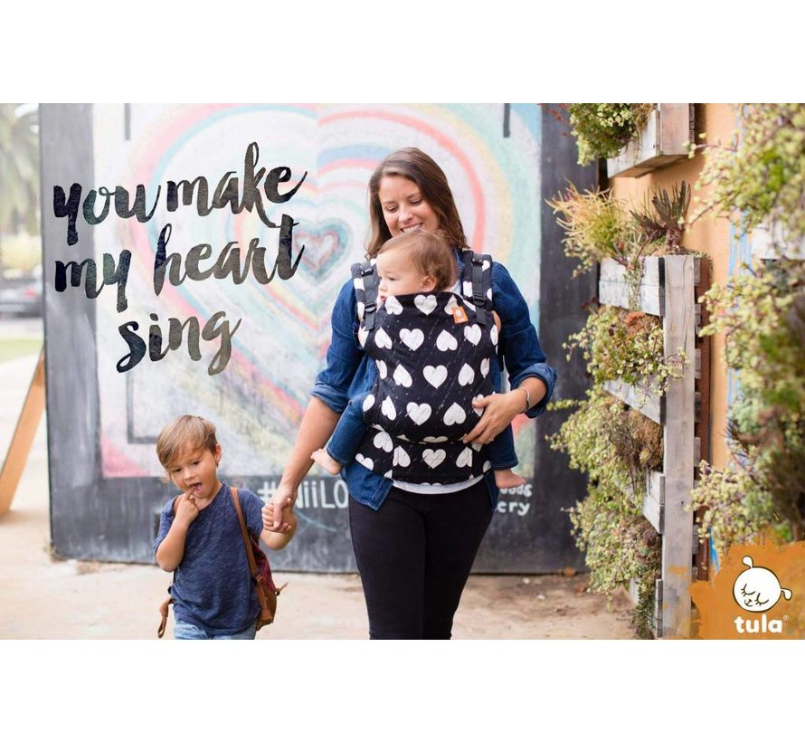 Tula Wild Hearts, carrier with hearts allover print.