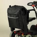Sac pour l'arrière d'une chaise roulante avec pochette pour la canne de marche