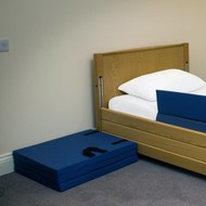 Drop-down mat for next to the bed