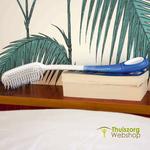 Ergonomic Etac hair wash brush with extended handle