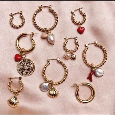 BY NOUCK BY NOUCK Earrings | TWISTED HOOPS PEARL SHELL | GOLD