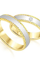 18 karat white and yellow gold wedding rings with matt and shiny finish with 0.03 ct diamond