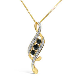 18 karat yellow & white gold pendant with 0.02 ct diamonds & 0.33 ct sapphire