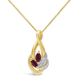 18 karat yellow & white gold pendant with 0.01 ct diamond & 0.20 ct ruby
