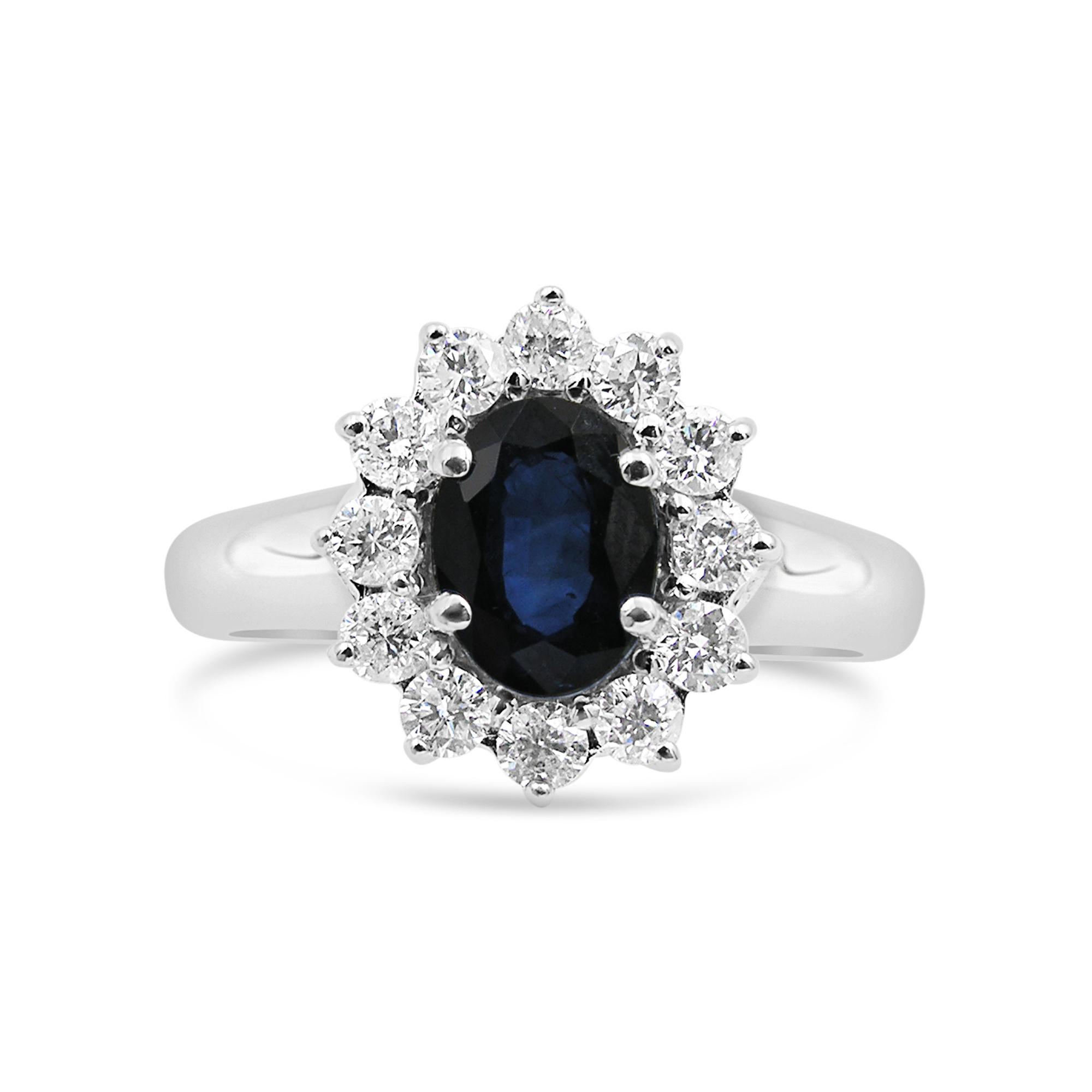 18 karat white gold ring with 0.60 ct diamonds  & 1.10 ct sapphire