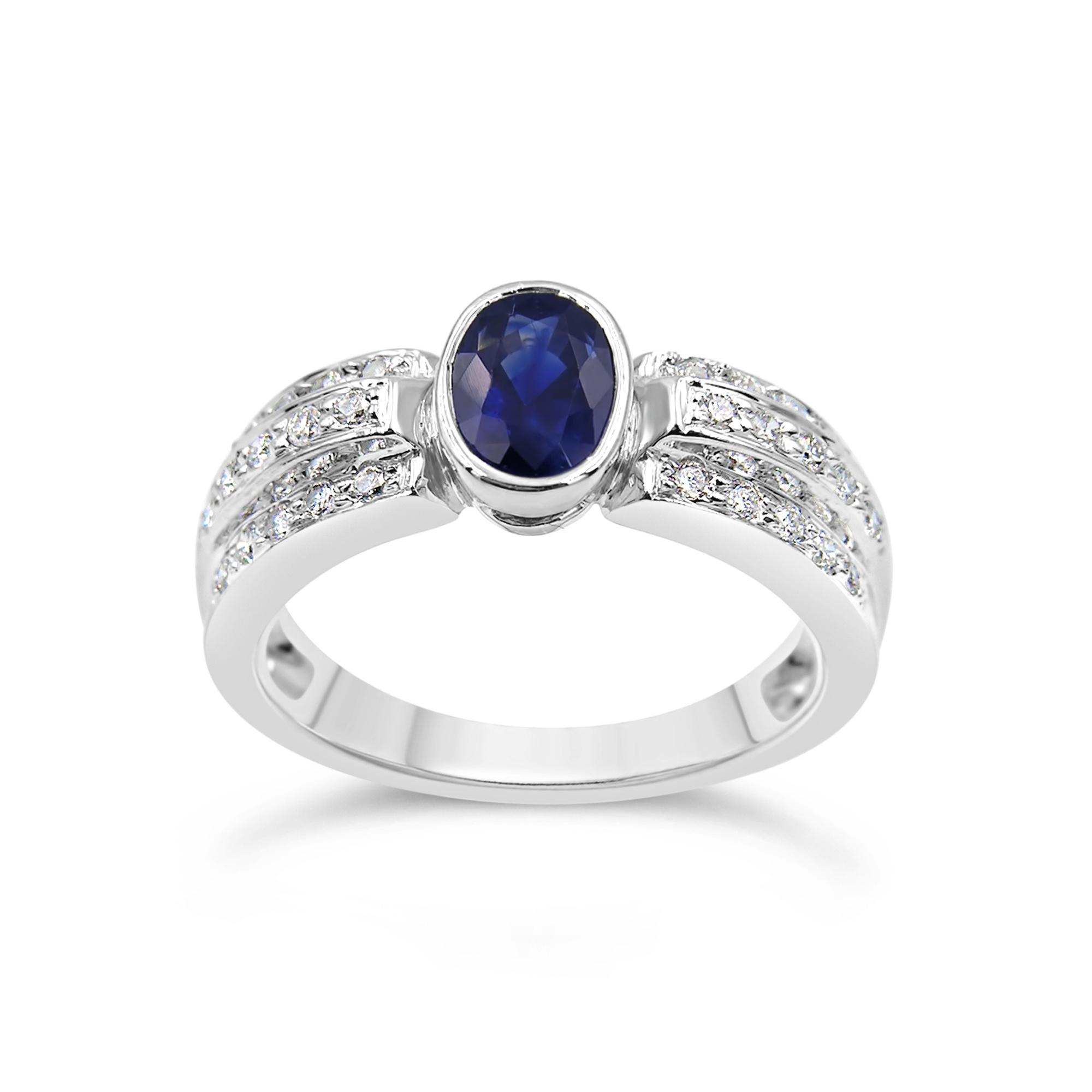 18 karat white gold ring with 0.28 ct diamonds  & 0.75 ct sapphire