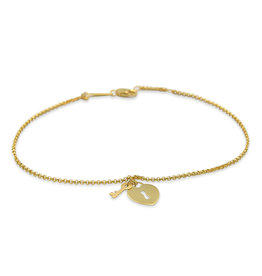 18 kt yellow gold charm bracelet with heart lock key