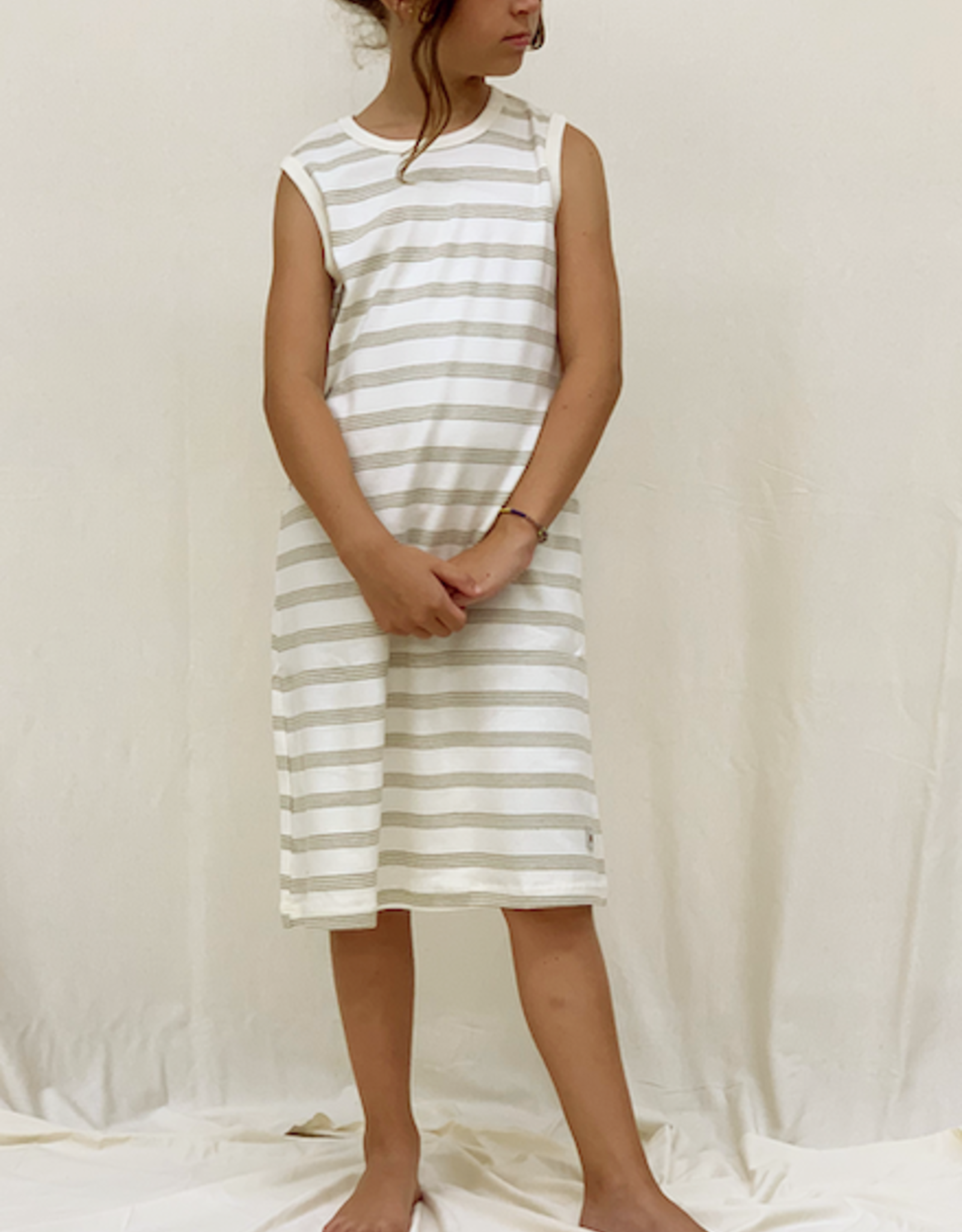 Junior sleeveless dress with stripes fabric. sizes 8, 10, 12 years.
