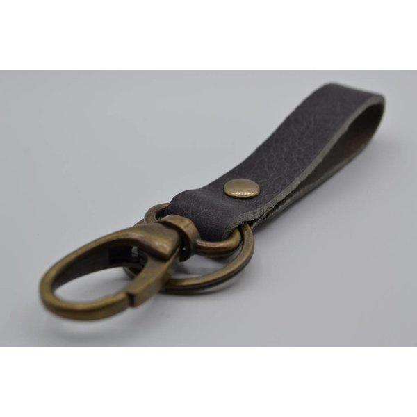 Scotts Bluf Sleutelhanger met naam gemaakt van nikkelvrije bronzen delen met Italiaans volnerf leer