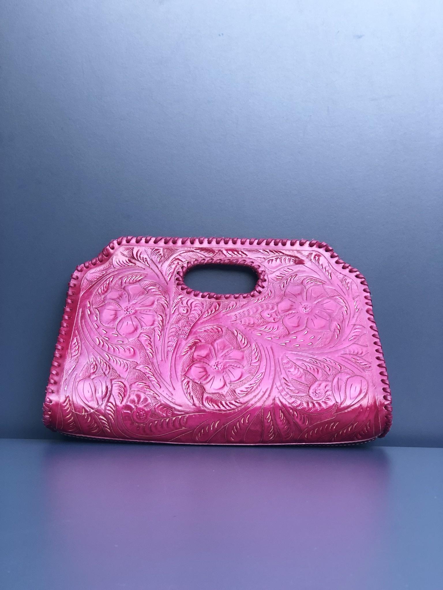 Handcarved leather bag