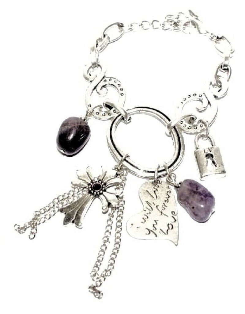 Silver metal bracelet with purple and silver charm beads