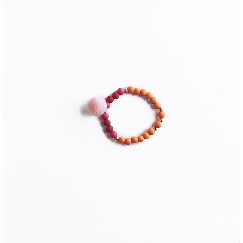 NJOOY Armbandje oranje/roze/rood met roze pompom