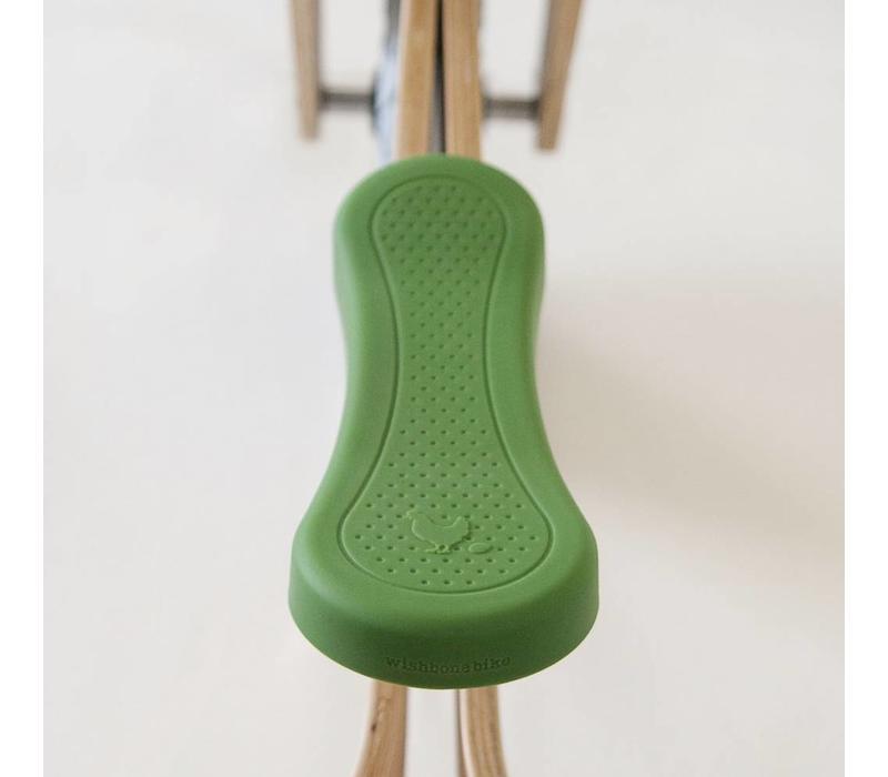 Groene zadelhoes voor Wishbone loopfiets!