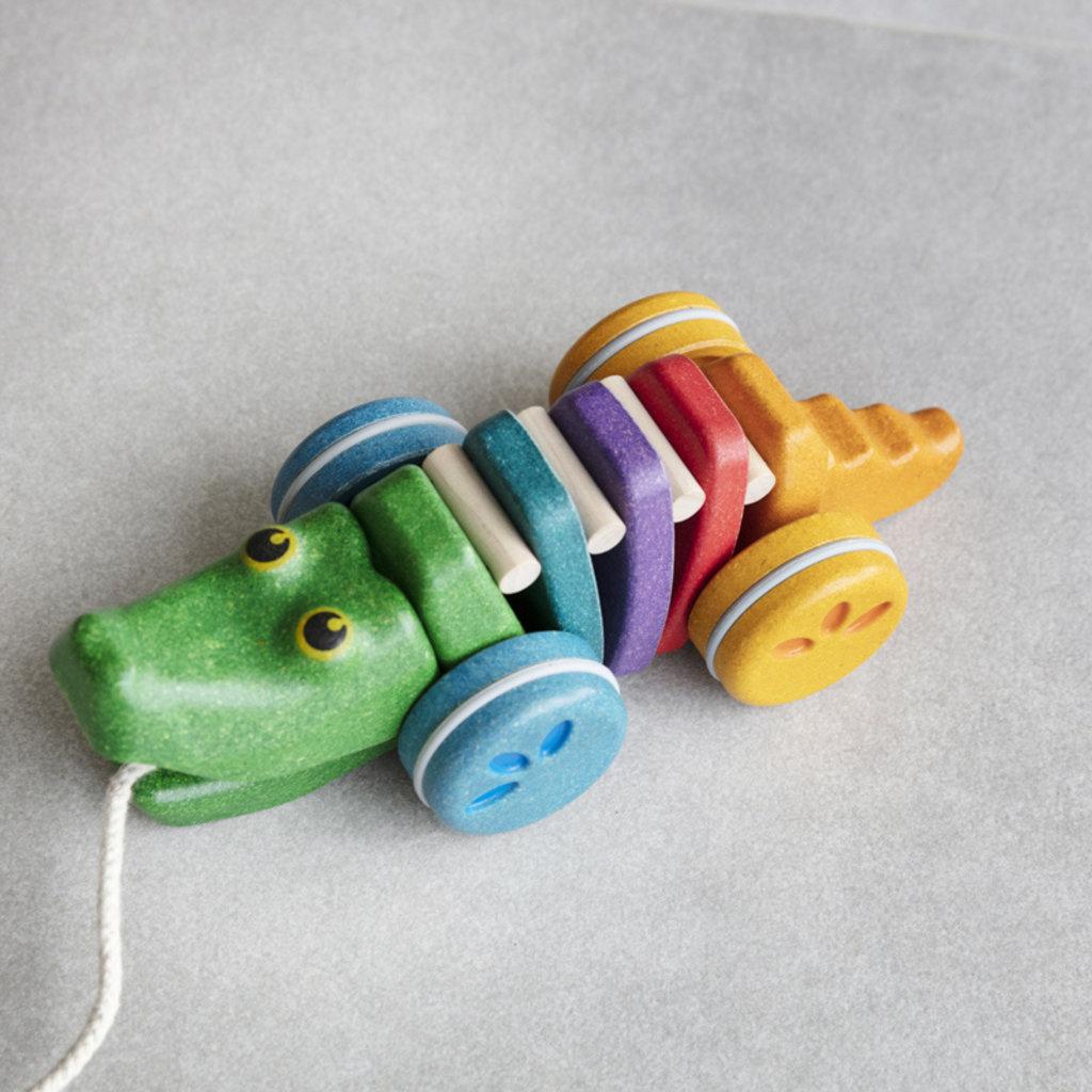 Plan Toys Dansende regenboogkrokodil