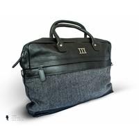 zwart lederen tas met grijze visgraat stof