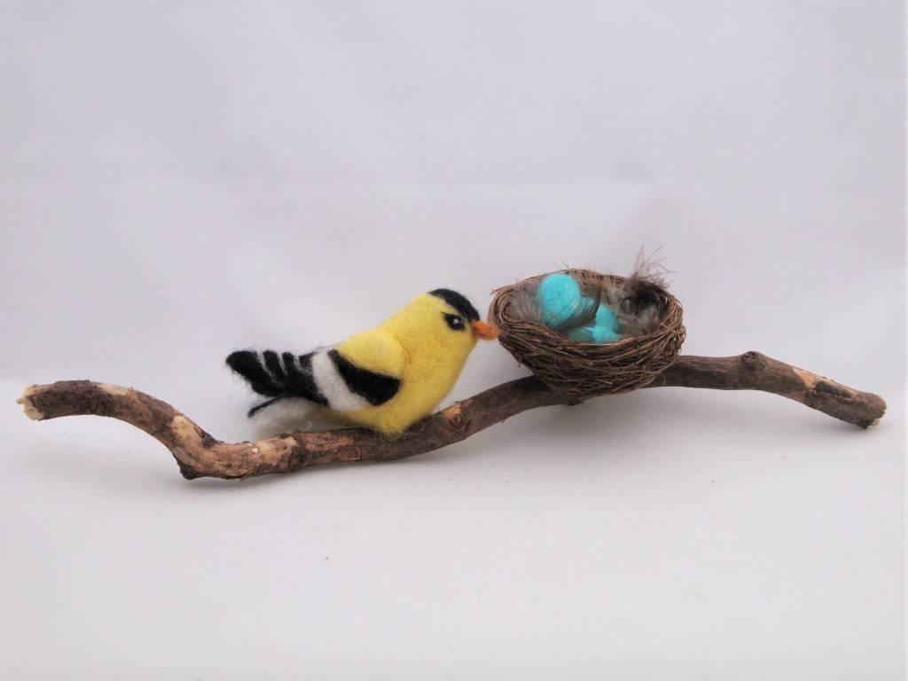 De Wolshoop Vogel met nest op tak