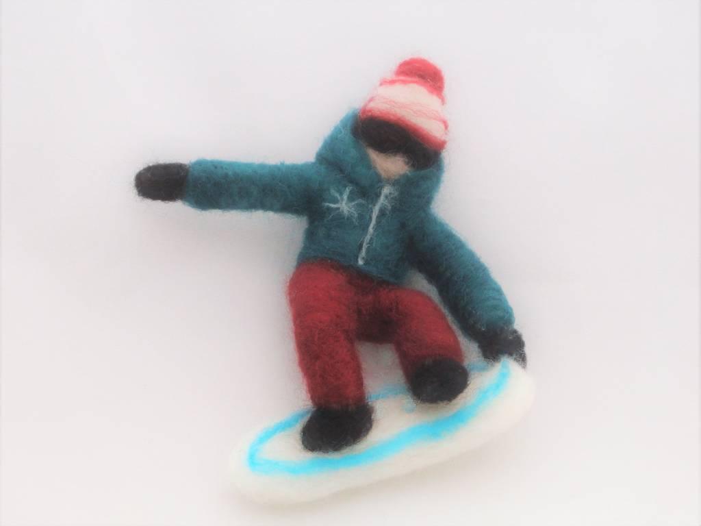 De Wolshoop snowboarder