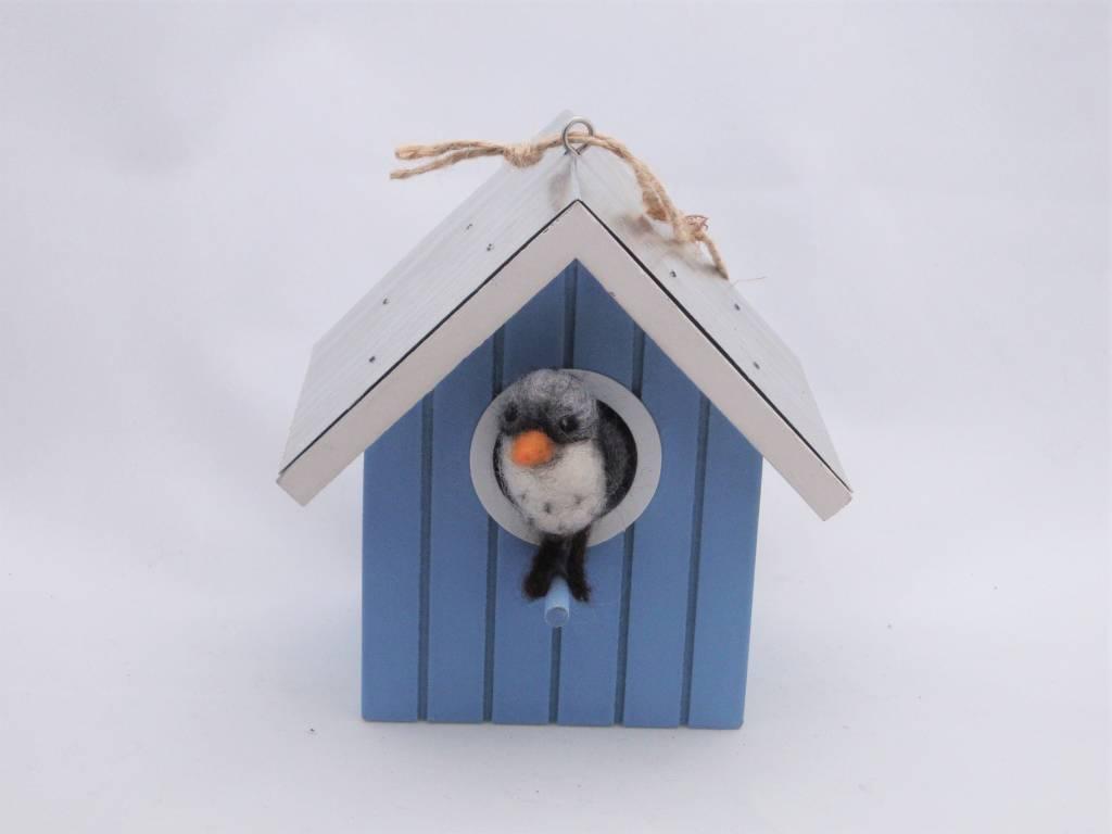 De Wolshoop Volgende in vogelhuisje