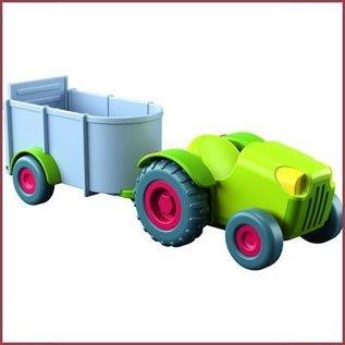 Haba Little Friends poppenhuisfiguurtje Tractor met aanhanger