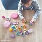 Grimm's 24 houten ringen om mee te bouwen Pastel