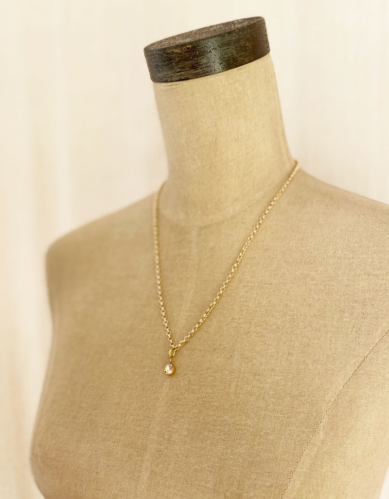 . KYRIA GOLD GILDED CHARM NECKLACE
