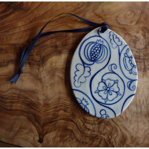 Decoración de cerámica oval Med. 059
