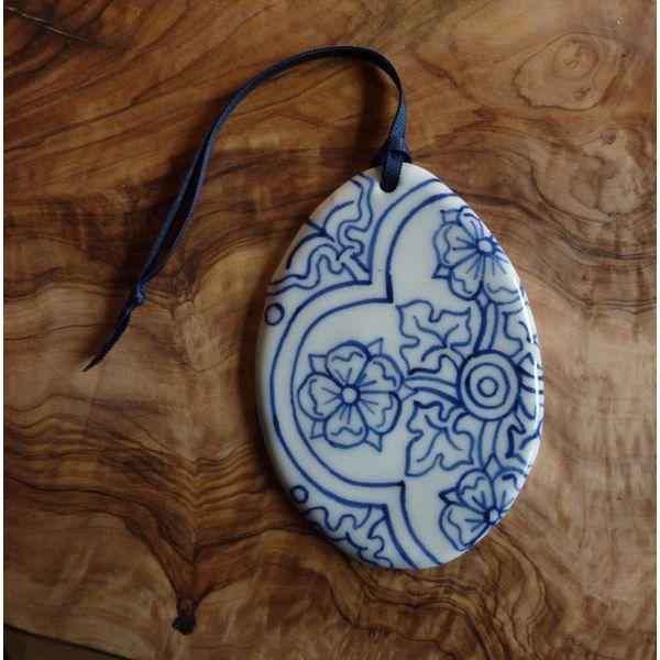 Decoración de cerámica oval Med. 060