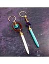 Amuleto de aretes de pavo real