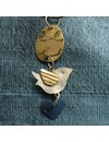 Bird silver and brass with disc and titaniam heart necklace