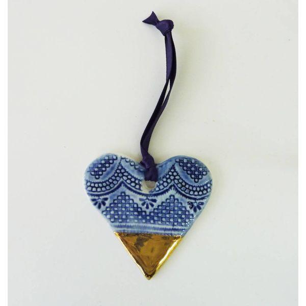 Adorno de corazón lustre de oro