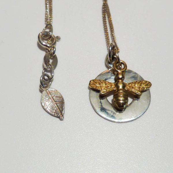 Silver disc with gold bee necklace
