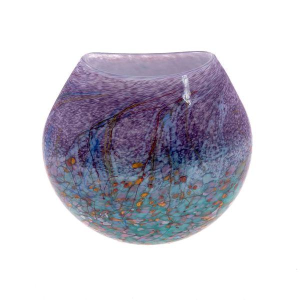 Florero plano púrpura del prado