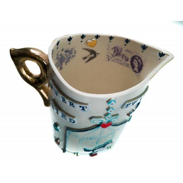 Tweet Porcelana de jarra de pájaro