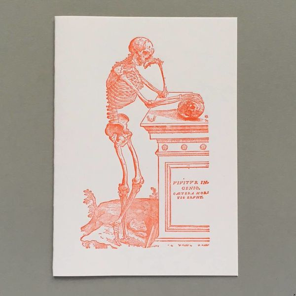 Skeleton contemplating a scull hand crafted letterpress card