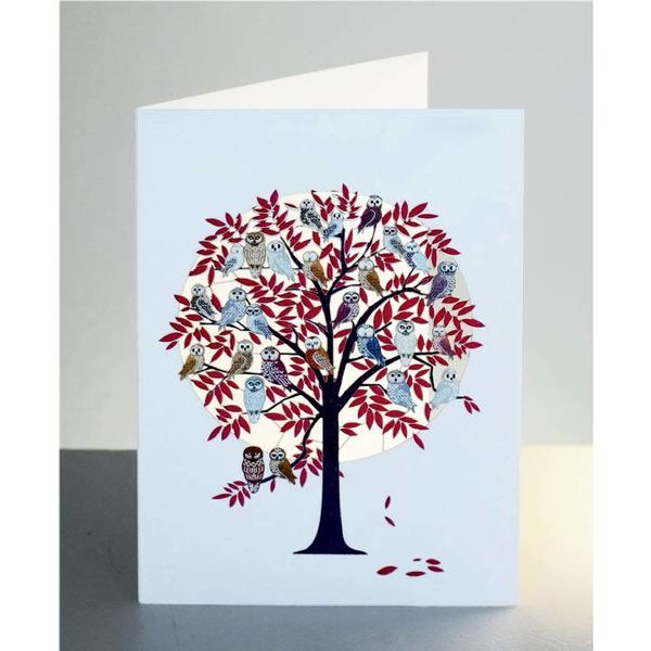 Red tree full of owls