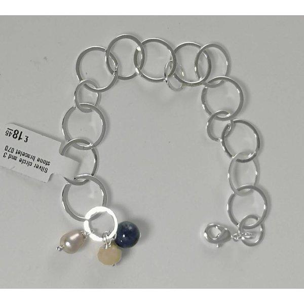 Círculo de plata y pulsera de piedra 3 070.