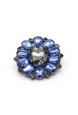 Brooch around blue / black stones