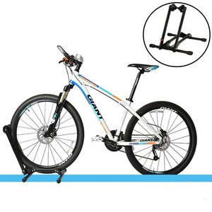 """Decopatent Fietsenrek Voor of Achterwiel - Fietsen Rek Racefiets, Mountainbike, Mtb etc - Fietshouder - Achterwiel Standaard / Voorwiel Standaard - Bike stand - fietsstandaard fietsen 24"""" 26"""" 27,5"""" inch en 700C - Opvouwbaar - Zwart - Decopatent®"""