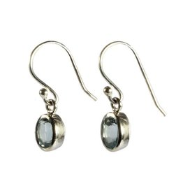 Zilveren oorbellen topaas (blauw) ovaal facet 7 x 5 mm
